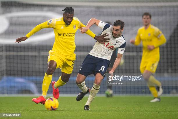 Harry Wink of Tottenham Hotspur and André-Frank Zambo Anguissa of Fulham during the Premier League match between Tottenham Hotspur and Fulham at...