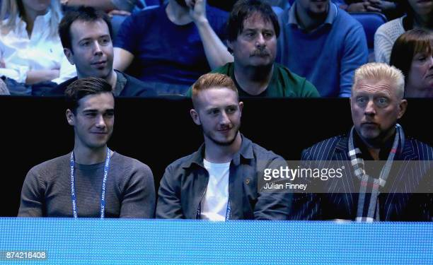Harry Winks and Boris Becker watch on during the singles match between Roger Federer of Switzerland and Alexander Zverev of Germany day three of the...