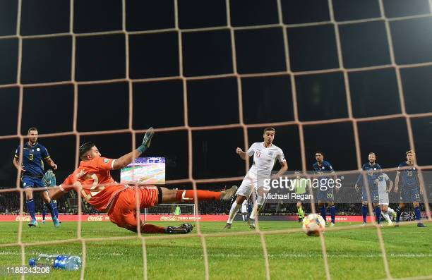 Harry Winks of England beats Arijanet Muric of Kosovo to score his team's first goal during the UEFA Euro 2020 Qualifier between Kosovo and England...