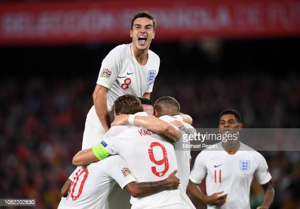 Harry Winks of England celebrates with team mates as as Raheem Sterling of England scores his team's third goal during the UEFA Nations League A...