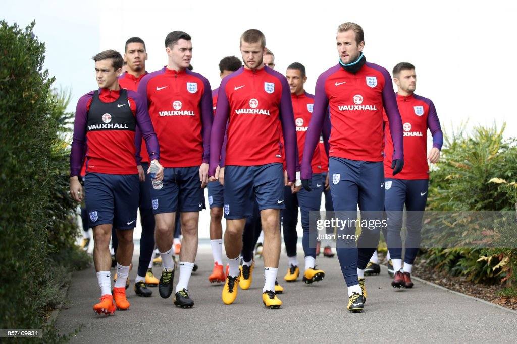 Harry Winks of England, Michael Keane of England, Eric Dier of England and Harry Kane of England all walk out prior to a England Training Session at the Tottenham Hotspur training ground on October 4, 2017 in Enfield, England.
