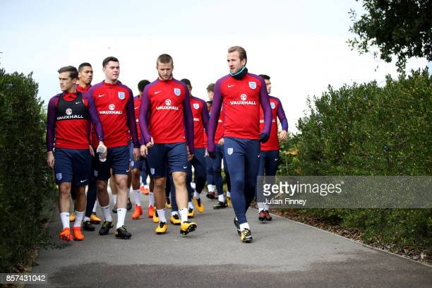 Harry Winks of England Michael Keane of England Eric Dier of England and Harry Kane of England all walk out prior to a England Training Session at...