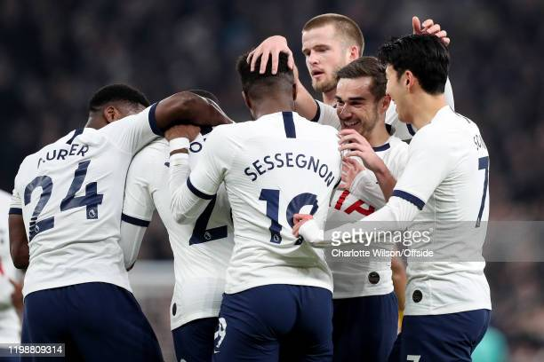 Harry Winks of Tottenham celebrates with Tanguy Ndombele, Ryan Sessegnon and Heung-Min Son after their 1st goal is scored by a Southampton own goal...