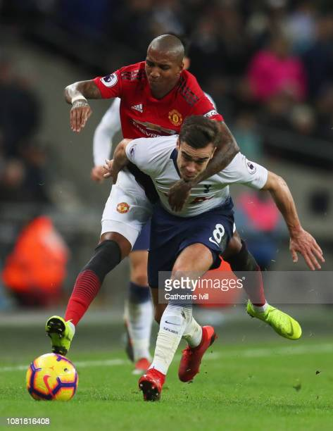 Harry Winks of Tottenham Hotspur and Ashley Young of Manchester United tangle during the Premier League match between Tottenham Hotspur and...