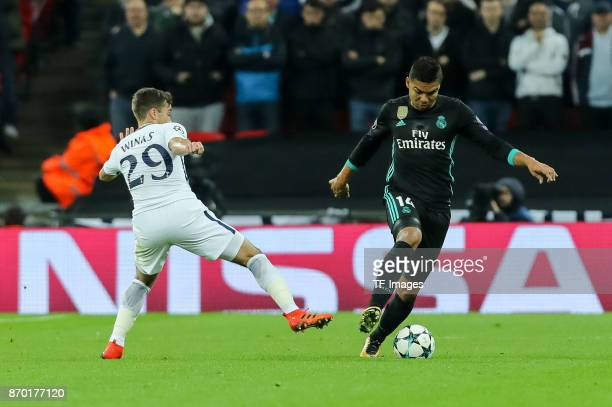 Harry Winks of Tottenham Hotspur and Casemiro of Real Madrid battle for the ball during the UEFA Champions League group H match between Tottenham...