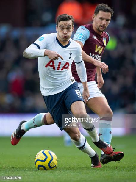 Harry Winks of Tottenham Hotspur and Danny Drinkwater of Aston Villa in action during the Premier League match between Aston Villa and Tottenham...