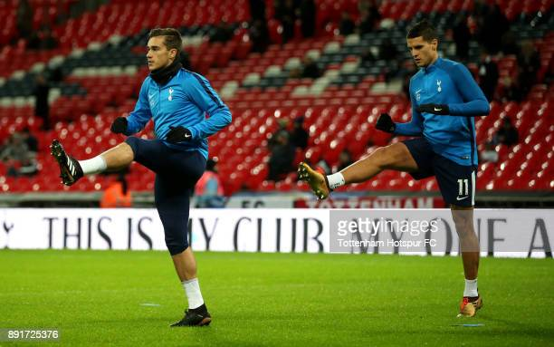 Harry Winks of Tottenham Hotspur and Erik Lamela of Tottenham Hotspur warm up prior to the Premier League match between Tottenham Hotspur and...