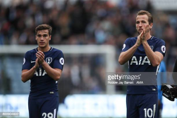 Harry Winks of Tottenham Hotspur and Harry Kane of Tottenham Hotspur applaud the fans at full time during the Premier League match between...