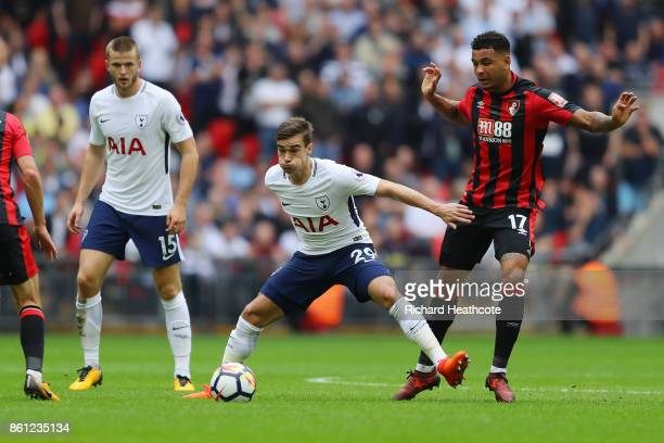 Harry Winks of Tottenham Hotspur and Joshua King of AFC Bournemouth battle for possession during the Premier League match between Tottenham Hotspur...