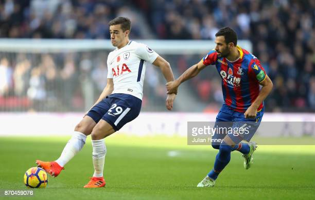 Harry Winks of Tottenham Hotspur and Luka Milivojevic of Crystal Palace battle for possession during the Premier League match between Tottenham...