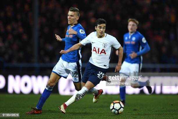 Harry Winks of Tottenham Hotspur and Mark Kitching of Rochdale AFC in action during The Emirates FA Cup Fifth Round match between Rochdale and...