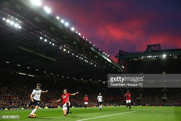 Harry Winks of Tottenham Hotspur and Matteo Darmian of Manchester United compete for the ball during the Premier League match between Manchester...