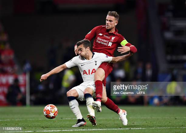 Harry Winks of Tottenham Hotspur battles for possession with Jordan Henderson of Liverpool during the UEFA Champions League Final between Tottenham...