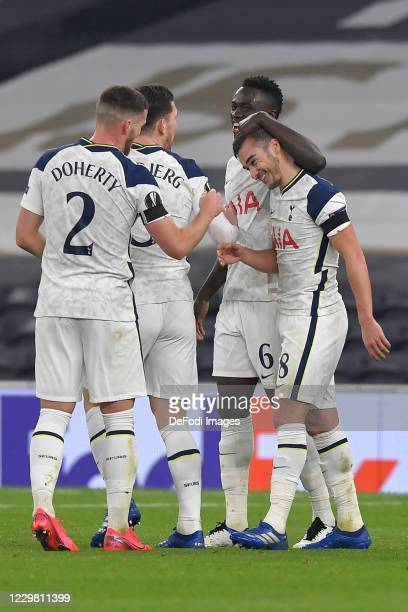 Harry Winks of Tottenham Hotspur celebrates after scoring his teams third goal with team mates during the UEFA Europa League Group J stage match...
