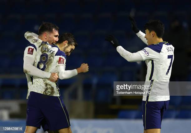 Harry Winks of Tottenham Hotspur celebrates after scoring their sides second goal with team mates Pierre-Emile Højbjerg and Son Heung-Min during The...