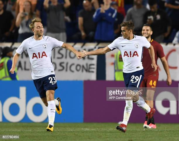 Harry Winks of Tottenham Hotspur celebrates scoring against AS Roma with teammate Christian Eriksen during their International Champions Cup football...