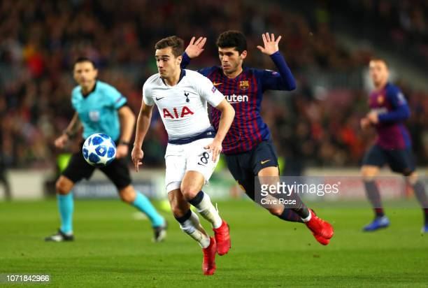 Harry Winks of Tottenham Hotspur evades Carles Alena of Barcelona during the UEFA Champions League Group B match between FC Barcelona and Tottenham...