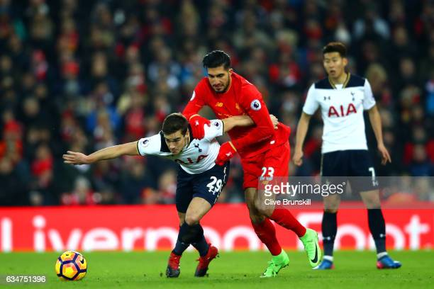 Harry Winks of Tottenham Hotspur is challenged by Emre Can of Liverpool during the Premier League match between Liverpool and Tottenham Hotspur at...