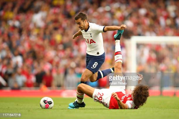 Harry Winks of Tottenham Hotspur is challenged by Matteo Guendouzi of Arsenal during the Premier League match between Arsenal FC and Tottenham...