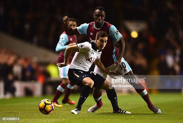 Harry Winks of Tottenham Hotspur is put under pressure from Michail Antonio of West Ham United during the Premier League match between Tottenham...
