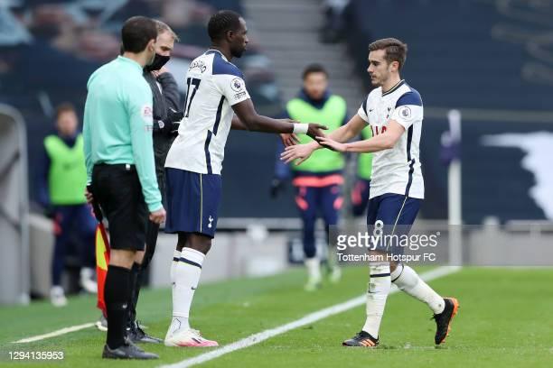 Harry Winks of Tottenham Hotspur is replaced by Moussa Sissoko of Tottenham Hotspur during the Premier League match between Tottenham Hotspur and...