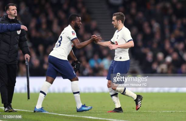 Harry Winks of Tottenham Hotspur is substituted for Tanguy Ndombele during the FA Cup Fifth Round match between Tottenham Hotspur and Norwich City at...