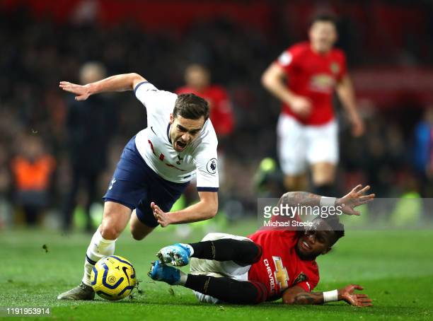 Harry Winks of Tottenham Hotspur is tackled by Fred of Manchester United during the Premier League match between Manchester United and Tottenham...