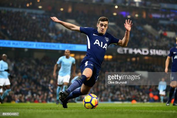 Harry Winks of Tottenham Hotspur runs with the ball during the Premier League match between Manchester City and Tottenham Hotspur at Etihad Stadium...