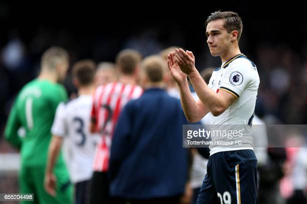 Harry Winks of Tottenham Hotspur shows appreciation to the fans after the Premier League match between Tottenham Hotspur and Southampton at White...