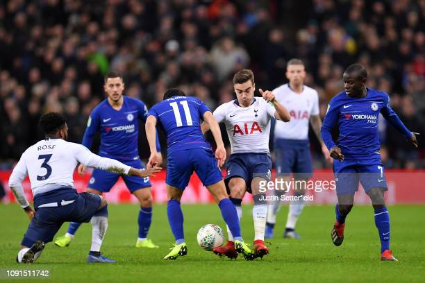 Harry Winks of Tottenham Hotspur tackles Pedro of Chelsea during the Carabao Cup SemiFinal First Leg between Tottenham Hotspur and Chelsea at Wembley...