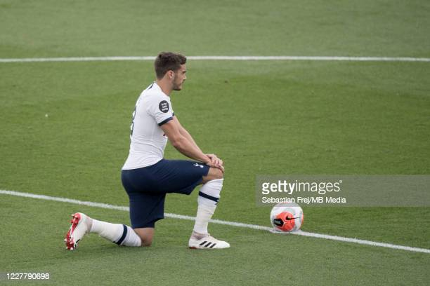 Harry Winks of Tottenham Hotspur take a knee during the Premier League match between Crystal Palace and Tottenham Hotspur at Selhurst Park on July 26...
