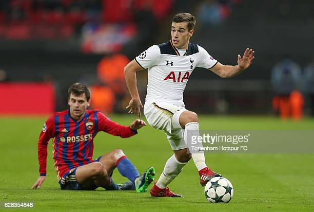 Harry Winks of Tottenham Hotspur takes the ball past Georgi Schennikov of CSKA Moscow during the UEFA Champions League Group E match between...
