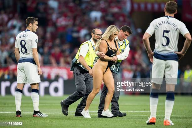 Harry Winks of Tottenham Hotspur Women streaker Kinsey Wolanski Jan Vertonghen of Tottenham Hotspur during the UEFA Champions League match between...