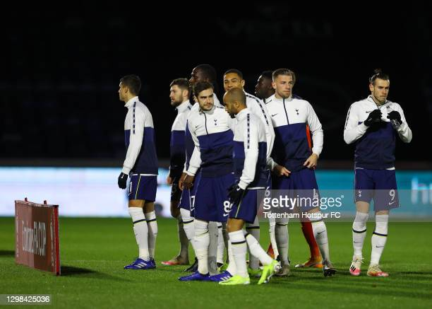 Harry Winks , Toby Alderweireld and Gareth Bale of Tottenham Hotspur line up prior to The Emirates FA Cup Fourth Round match between Wycombe...