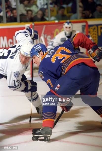 Harry York of the St. Louis Blues skates against Mats Sundin of the Toronto Maple Leafs during NHL game action on December 3, 1996 at Maple Leaf...