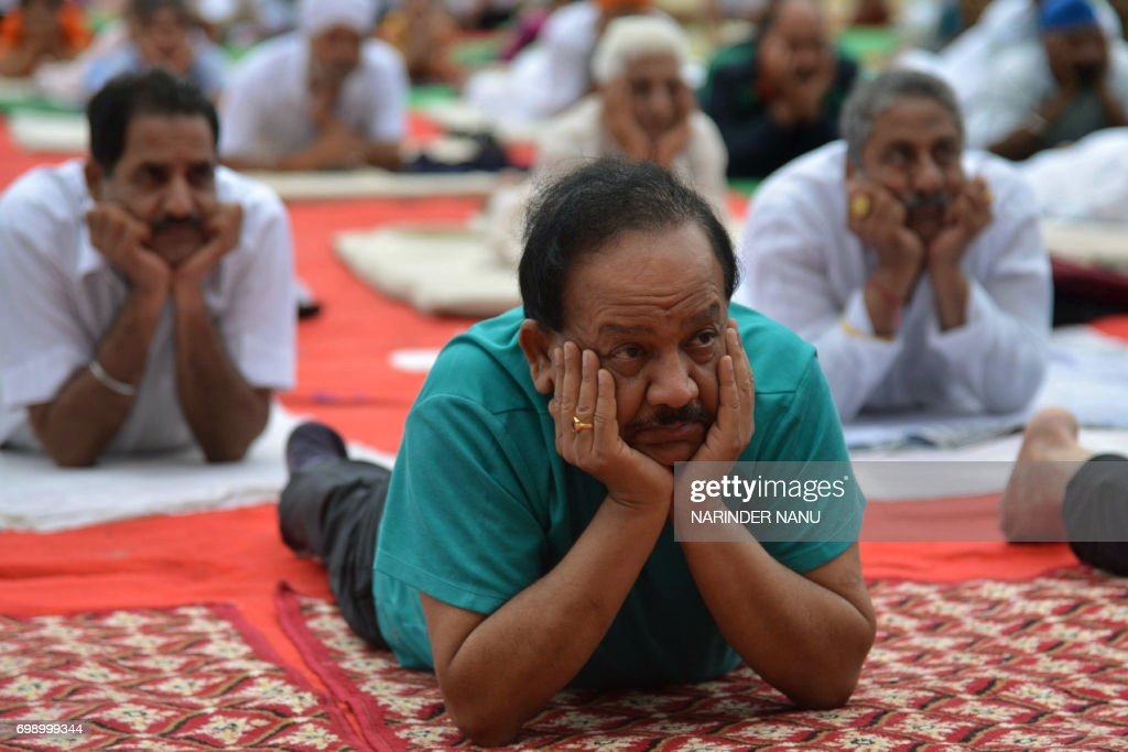 Harsh Vardhan Indian Union Minister for Environment Science and Technology takes part in a yoga session on International Yoga Day in Amritsar on June.