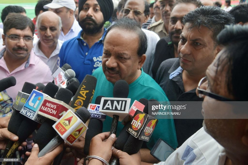 Harsh Vardhan Indian Union Minister for Environment Science and Technology talks to the media after a yoga session on International Yoga Day in...