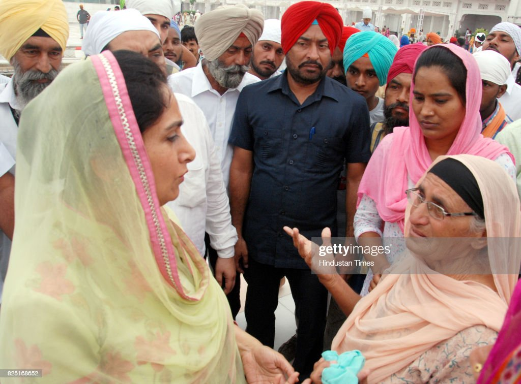 Harsimrat Kaur Badal Union Minister for food processing industries meets devotee after paying obeisance at Golden Temple on July 31 2017 in Amritsar..