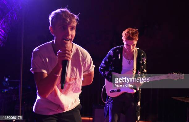 Hart Denton and KJ Apa of The Good Time Boys perform during Teen Vogue's Young Hollywood Party presented by Snap at Los Angeles Theatre on February...