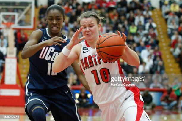 Hartford's Alex Hall right drives against Connecticut's Brianna Banks during the second half at the Chase Family Arena in West Hartford Connecticut...