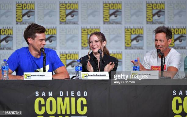 """Hartley Sawyer, Danielle Panabaker and Tom Cavanagh speak at """"The Flash"""" Special Video Presentation and Q&A during 2019 Comic-Con International at..."""