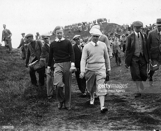 Hartley walks with the American golfer Bobby Jones to the next green during the Walker Cup contest at Royal St George's Links at Sandwich.
