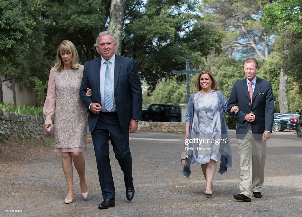Hartmut and Gabriele Lademacher and Grand Duke Henri and Grand Duchess Maria-Teresa of Luxembourg attend the baptism ceremony of Princess Amalia, at the Saint Ferreol Chapel in Lorgues on July 12, 2014 in Lorgues, France.