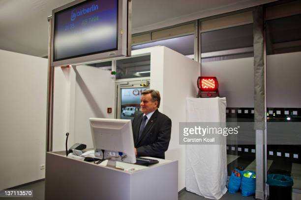 Hartmut Mehdorn CEO of Air Berlin stands behind the boarding counter at the launch of Air Berlin service to Abu Dhabi at Tegel Airport on January 15...