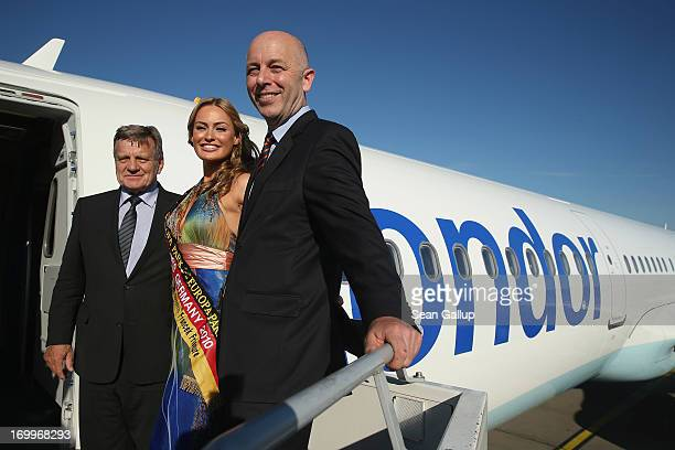 Hartmut Mehdorn Chairman of Berlin Brandenburg International Airport former Miss Germany Anne Julia Hagen and Uwe Balser head of Condor airlines pose...
