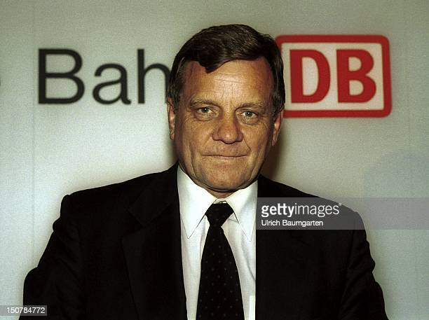 Hartmut MEHDORN chairman of the board of management of the Deutsche Bahn AG in front of the Deutsche Bahn logo