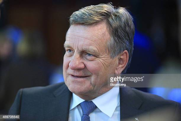 Hartmut Mehdorn, chief executive officer of Berlin Brandenburg Airport, reacts following his speech at the Suddeutsche Zeitung economic summit in...