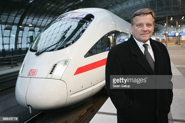 Hartmut Mehdorn head of the German state railways company Deutsche Bahn AG poses next to a Deutsche Bahn ICE highspeed train at a promotional event...