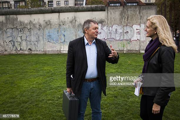 Hartmut Richter is pictured during an interview along remains of the 'Wall' along Bernauer strasse in Berlin on October 8, 2014. Richter fled the...