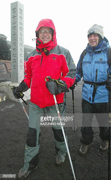 Hartwig Gauder former German Olympic champion and a supporter arrive at the top of the summit of Mt Fuji776metre 19 July 2003 Gauder is on a twoday...